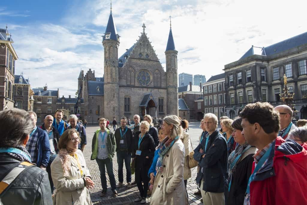 People during a guided tour around the Binnenhof